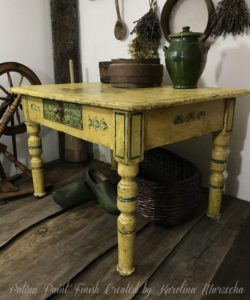 Yellow ochre patina painted table with green detail painted by a student
